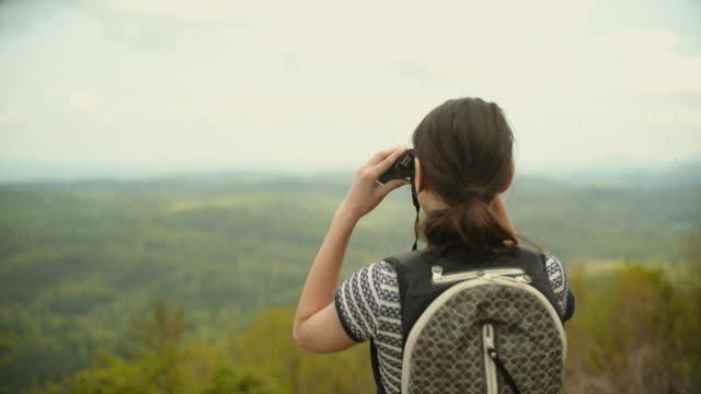 14 years old teenager girl observing Cherokee National Forest in Great Smoky Mountains, Appalachian, from Cherahola Skyway, Tennessee, USA.
