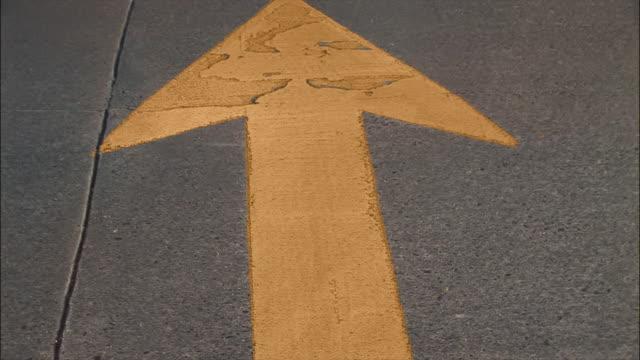 CU, ZO, yellow arrow sign on tarmac
