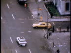 Yellow cab driving through Harlem; 1970s