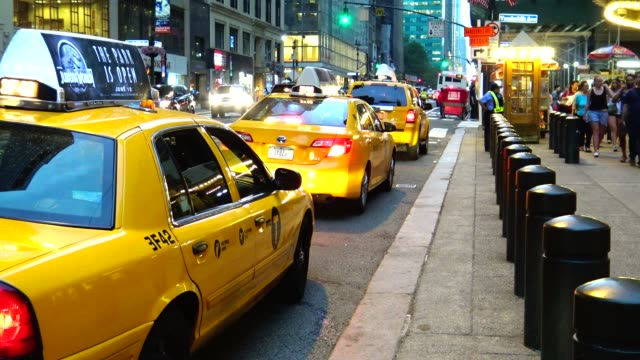 Yellow Taxis during summer in waiting area outside Grand Central Terminal during evening / Park Avenue Midtown Manhattan New York City