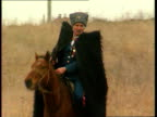 Yeltsin deploys Cossacks to police Chechnya RUSSIAN FEDERATION Caucus Mountains MS Cossack in hat and shaggy black coat carrying rifle as riding...