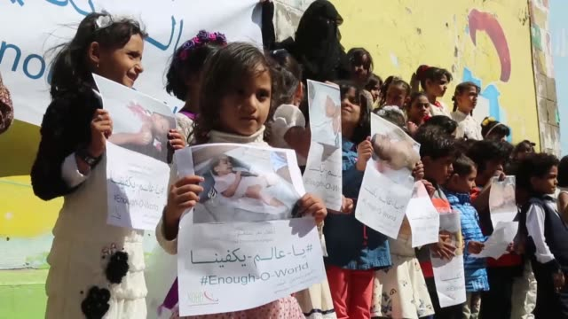 Yemeni children take part in a protest on November 20 2017 in Taiz Yemen Protestors demand the UN and the world help Yemen's children by ending the...