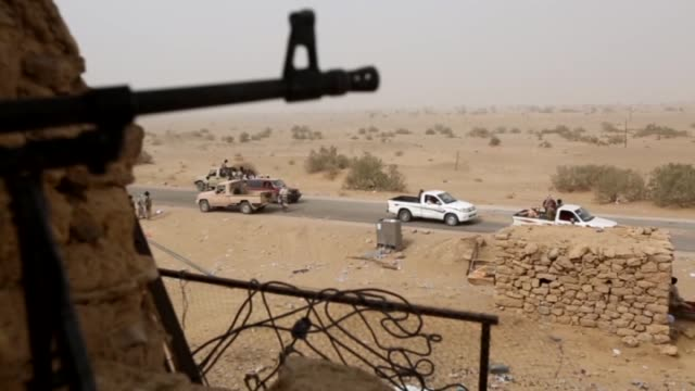 Yemeni fighters from Popular Resistance Forces loyal to Yemeni President Abd Rabbuh Mansur Hadi patrol after seizing control of the historic city of...