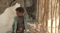 Yemeni people inspect the debris of their houses destroyed after airstrikes within 'Decisive Storm' operation staged by Saudiled coalition against...