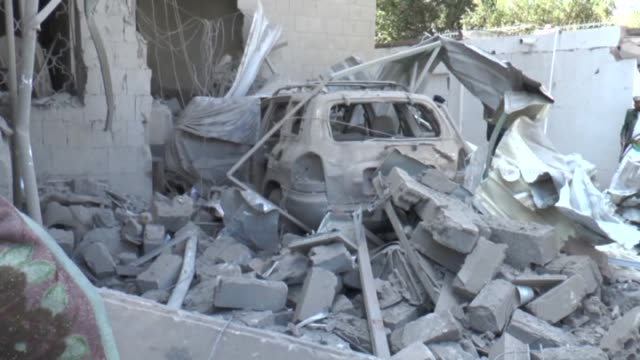 Yemeni security forces inspect the bombing area around the residence of the Iranian ambassador in Sanaa Yemen on December 3 2014 According to...