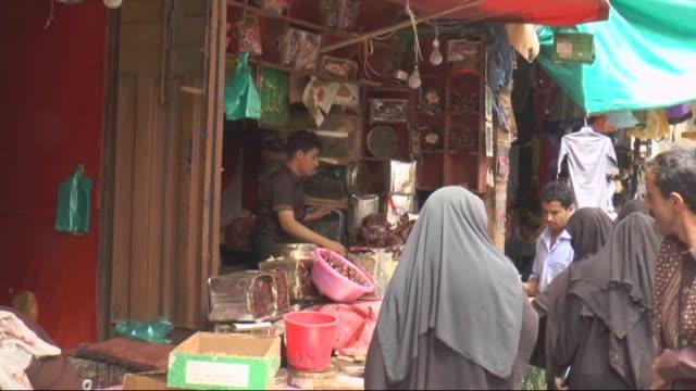 Yemenis buy dates as they shop at Bab'ul Yemen bazaar during the holy month of Ramadan in Sanaa Yemen on June 21 2015
