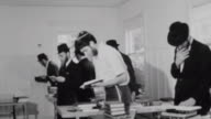 Yeshiva students deep in prayer at the Chabad House at the University of Washington / Close up of Rabbi Samuels / Religious Prayer at Chabad House on...