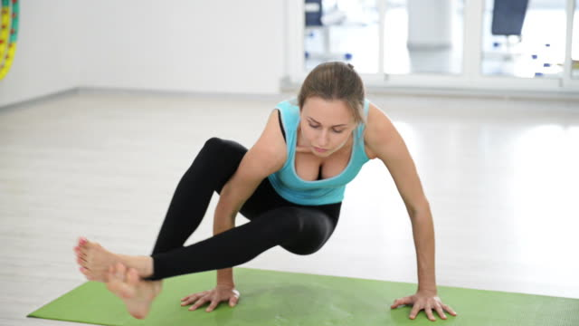Yoga fitness session with young attractive girl.