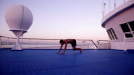 Yoga on ship in the evening vrcsasana and bhujangasana