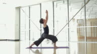 WS DS Yoga student practicing yoga in yoga studio / Vancouver, British Columbia, Canada