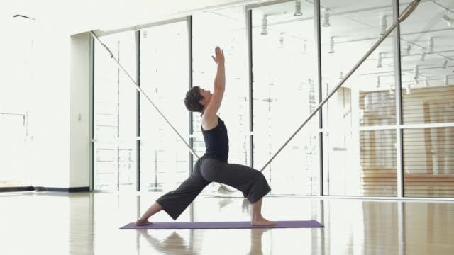 WS DS Yoga student practicing yoga in yoga studio / Vancouver, British Columbia, Canada
