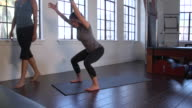 'MS PAN Yoga student practicing yoga pose with instructor / Beverly Hills, California, United States'