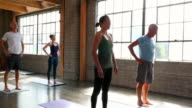 MS Yoga students in big toe pose during class in studio