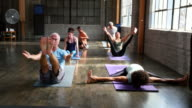 MS Yoga students in various poses during class in studio