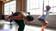 MS LA Yoga students practicing sequence before class in studio