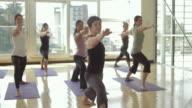 MS DS Yoga students practicing yoga in yoga studio / Vancouver, British Columbia, Canada
