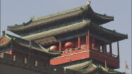 MS Yonghe Temple rising above Badaling section of Great Wall of China, Beijing, China