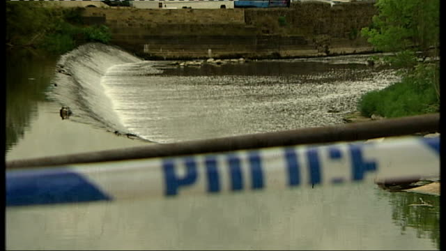 Yorkshire Bradford Shipley EXT Close Shot of police cordon tape REFOCUS to River Aire GV Water with reflection of tree GV Ducks sitting on weir...