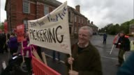Yorkshire Northallerton Various shots protesters with antifracking placards / Demonstrators chanting SOT / General views protest / Woman gives speech...