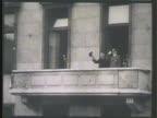 Yosuke Matsuoka Adolf Hitler appearing on balcony MS Matsuoka saluting w/ hat Hitler next to him BG VS Crowds of Germans cheering MS Matsuoka Hitler...