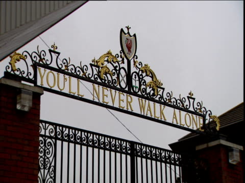 You'll Never Walk Alone on Bill Shankly memorial gate pull focus Anfield football stadium Liverpool