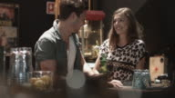 Young adult couple on date in bar