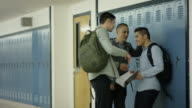 Young adult males bullying another student