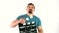 Young adult man using movie film clapperboard or film slate