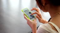Young Adult playing Smart phone