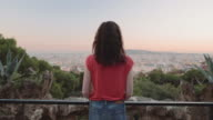 Young adult woman enjoying view of Barcelona