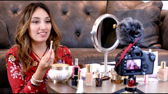 Young adult woman vlogging about cosmetics, skin care products.