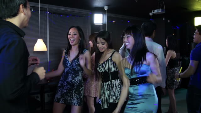Young adults at an Asian nightclub