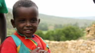 Young Afar boy covered in flies on August 16 2011 on Road from Makele to Addis Ababa Ethiopia