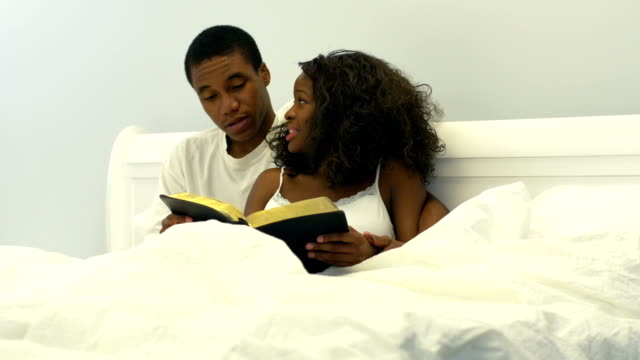 Young African American couple in bed