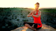 Young African American Woman Doing Yoga in Desert
