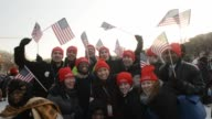 Young Americans waving flags and posing for photos are excited and enthusiastic in support of President Barack Obama's inauguration at the National...