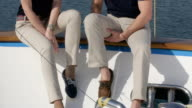 Young and beautiful couple on yacht.