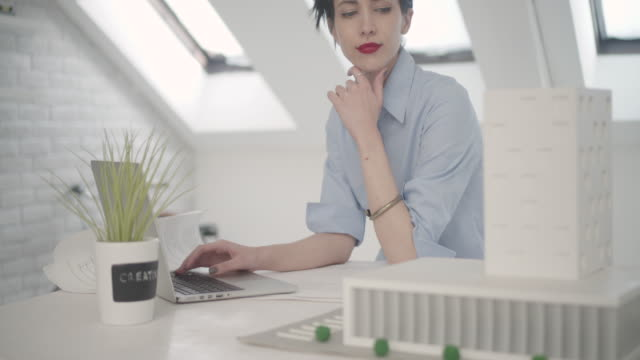 4K: Young Architect Working In Her Office.