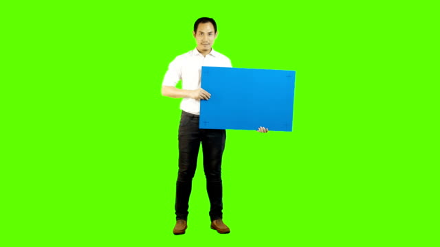 Young asian man holding a blank signboard,Blue screen.