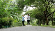 Young asian two girls jogging
