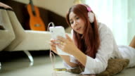 Young asian woman listening to music