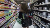 Young asian woman shopping in grocery store.