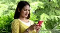 Young Asian Woman Texting with Smart Phone