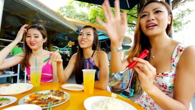 Young Asian Women Enjoying a Meal Together
