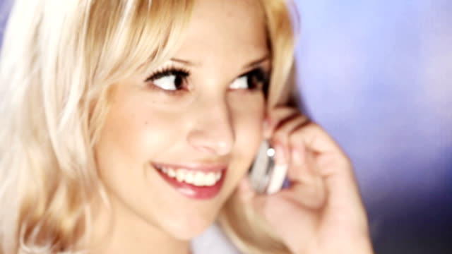 HD: Young attractive woman talking on the phone