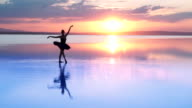 Young Ballerina Dancing on Water