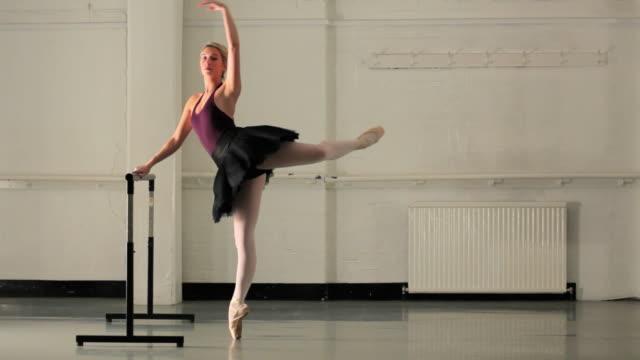 WS Young ballerina rehearsing in dance studio / London, England