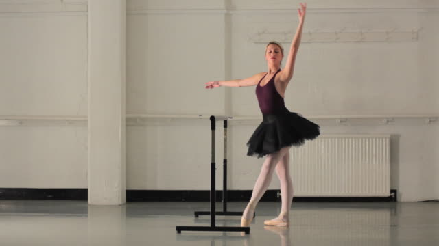 WS Young ballerina rehearsing in dance studio / London, England