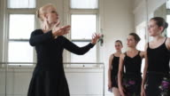young ballerinas in a row with instructor