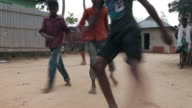 Young bangladeshi boys playing football in a village not far from Srimangal, Sreemangal (Srimangal), Division of Sylhet, Bangladesh, Indian Sub-Continent, Asia, Indian Sub-Continent, Asia